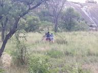 Bukhosi & Antonio exploring an ant hill